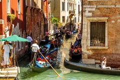16. jul 2012 - heavy traffic of gondolas on the canal in venice - stock photo