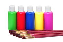 Brushes and acrylic paints on a white background Stock Photos