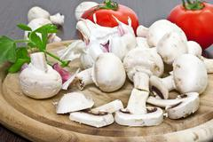 Stock Photo of field mushrooms with tomatoes and garlic