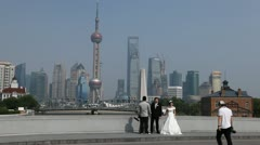 Wedding Shoot in front of Shanghai Skyline, China, Bride and Groom Photography Stock Footage