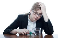 Unhappy woman with headache Stock Photos
