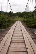 Wooden Bridge Across Pastaza River In Ecuador Stock Photos