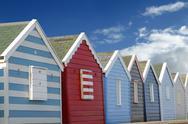 Beach huts and blue sky Stock Photos
