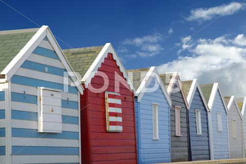 Stock photo of Beach huts and blue sky