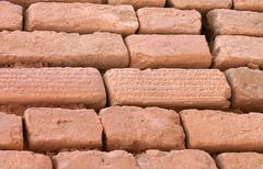 Stock Photo of brick wall with cuneiform writing on bricks, shush, iran