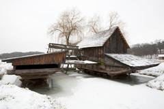 Traditional Romanian Floating Mill On A Frozen Lake Stock Photos
