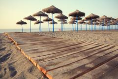Mediterranean Beach In Early Morning Light Torre Del Mar Andalusia Spain - stock photo