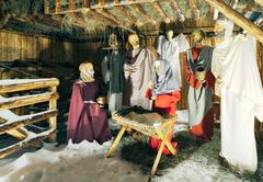 Stock Photo of Holly Scene From The Barn Where Jesus Was Born Wax Characters In The Spot Light
