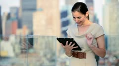 Caucasian financial manager using touch screen in Manhattan office rooftop  Stock Footage