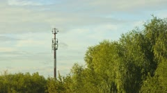 clouds over antenna and trees - stock footage