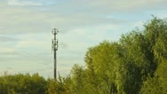 Clouds over antenna and trees Stock Footage