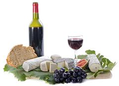 Goat cheeses, fruits and wine Stock Photos