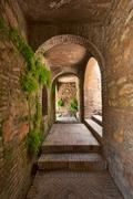 Alhambra Corridor In Spain With Typical Moorish Arches - stock photo