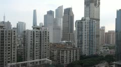 Fast motion of Aerial view of Guangzhou, blurred logos, China Stock Footage