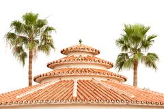 Circular Exotic Rooftop Surrounded By Palm Trees - stock photo