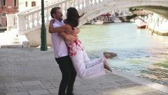 Rich happy couple in love in Venice, slow motion Stock Footage