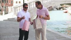 Stock Video Footage of Happy rich male friends with shopping bags in Venice