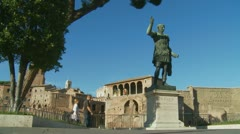 Caesar statue in Rome, tourists walk by (3) Stock Footage