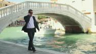 Rich man with cellphone smoking cigar in Venice Stock Footage