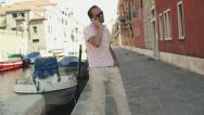 Rich man with cellphone standing in Venice Stock Footage