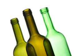 Three green empty bottles Stock Photos