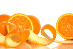 Orange peel and juicy oranges Stock Photos