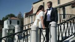 Just married couple fighting on the bridge in Venice Stock Footage