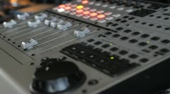 Closeup of audio mixing console Stock Footage