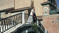 Happy just married couple on the bridge in Venice - stock footage