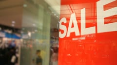 Red Sale Sign in Crowded Shopping Mall. Stock Footage