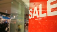 Stock Video Footage of Red Sale Sign in Crowded Shopping Mall.