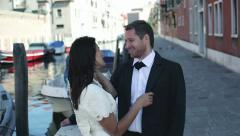 Happy just married couple talking near canal in Venice - stock footage