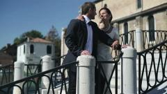Happy just married couple standing on the bridge in Venice and talking - stock footage