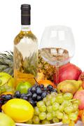 Still life - bottle of wine, glass and tropical fruit Stock Photos