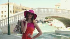Rich woman in hat with shopping bugs in Venice Stock Footage