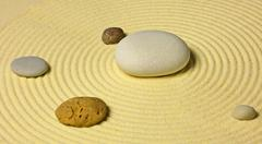 Scheme of solar system from stones on sand Stock Photos