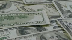 Hundred dollar bills panning left Stock Footage