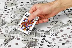 Queen of spades in hand Stock Photos
