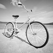 old-fashioned bicycle - monochrome picture - stock photo