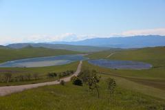 meadows, country road and two lakes near david gareja monastery. kakheti. geo - stock photo