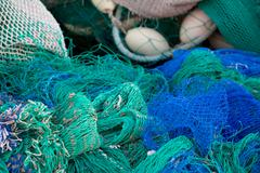 Multicolor Fishing Nests And Buoys In Harbor Area Stock Photos