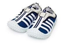 Sports inexpensive shoes on white Stock Photos