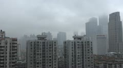 Fast motion of Aerial view of Guangzhou in fog, China Stock Footage