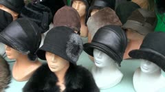 Autumn and winter seasons caps in fair Stock Footage