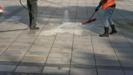 Stock Video Footage of workers cleaning city square  pavement
