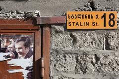 Stock Photo of half torn election banner on stalin st. in mestia. upper svaneti. georgia.