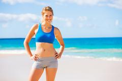 beautiful athletic woman at the beach - stock photo