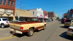 Pickup Trucks Down Small Town Main Street- Shawnee OK Stock Footage