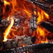 Wood burning in the fire background Stock Photos
