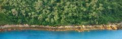 Panorama of tropical ocean shoreline Stock Photos